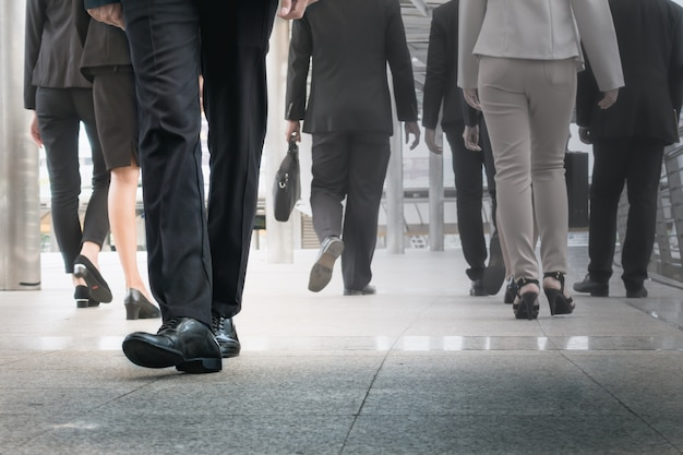 Businessman legs walking go forward as outstanding