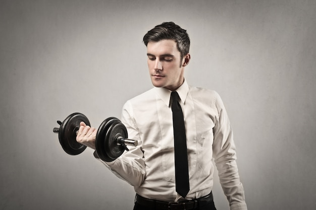 Businessman lifting weight