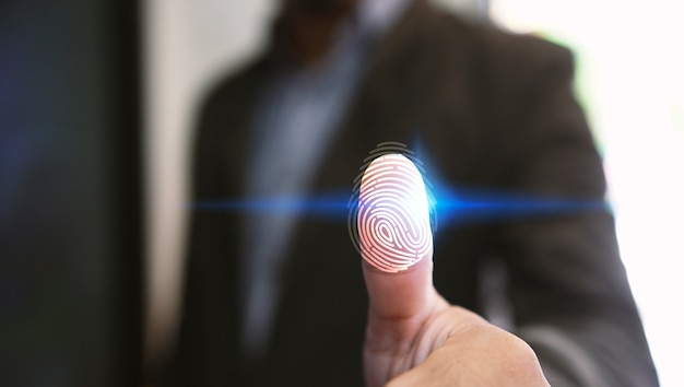 Businessman login with fingerprint scanning technology. fingerprint to identify personal, security system