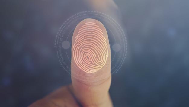 Бизнесмен логин с технологией сканирования отпечатков пальцев. отпечаток пальца, чтобы идентифицировать личность, концепцию системы безопасности