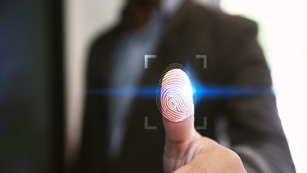 Businessman login with fingerprint scanning technology.