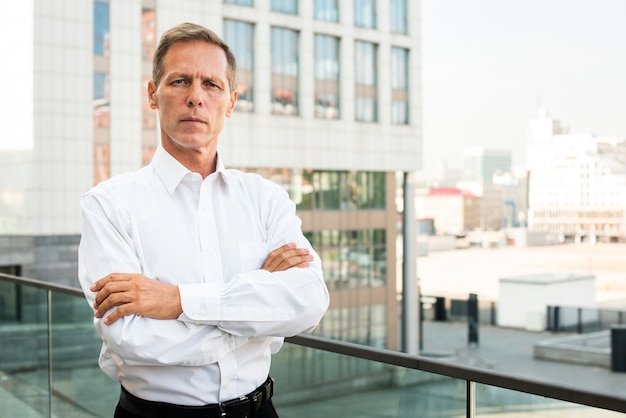 Businessman looking at camera with arms crossed