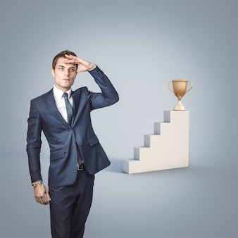 Businessman looks away to look for the award. concept of success and determination.