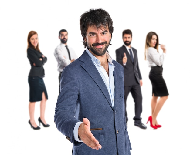 白い背景の上で取引をしているビジネスマン
