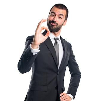 Uomo d'affari che fa segno ok