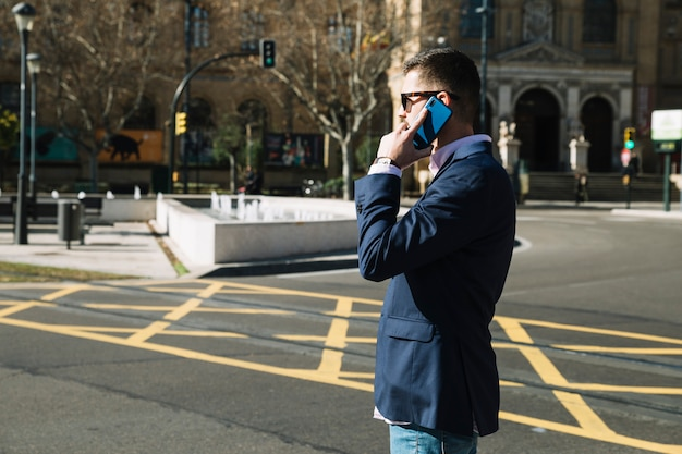 Businessman making phone call in urban environment