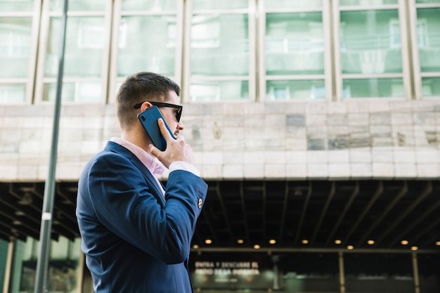 Businessman making phone call in urban environment