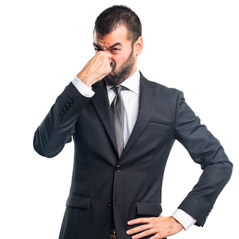 Businessman making smelling bad gesture