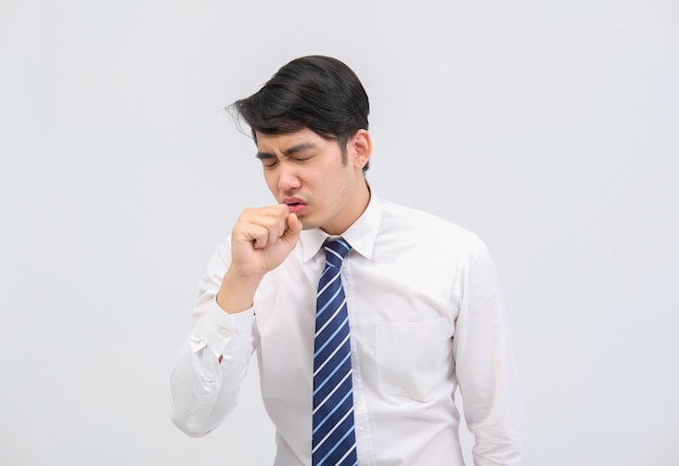 Businessman man feeling sick, sneezing coughing from cold flu virus bacteria infection pollution