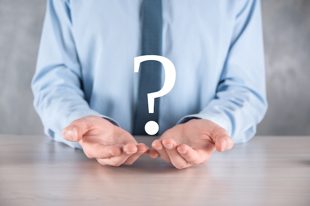 Businessman man hand hold interface question marks sign web.