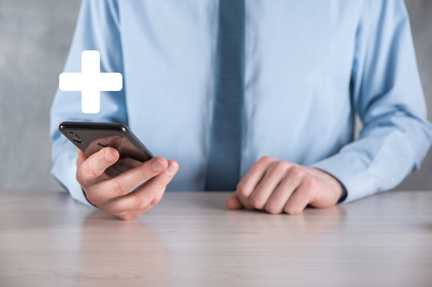 Businessman, man hold in hand offer positive thing such as profit, benefits, development, csr represented by plus sign