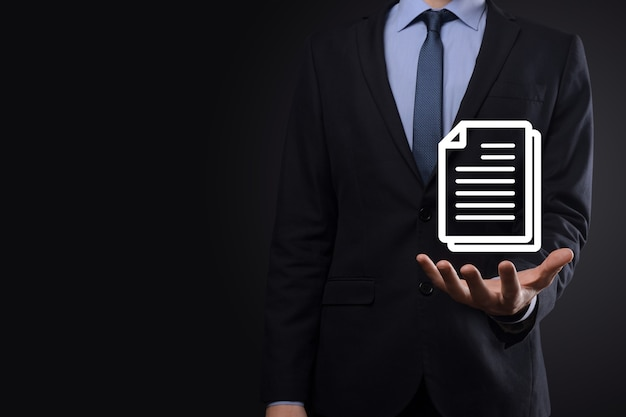 Businessman man holding a document icon in his hand document management data system business internet technology concept. corporate data management system dms .
