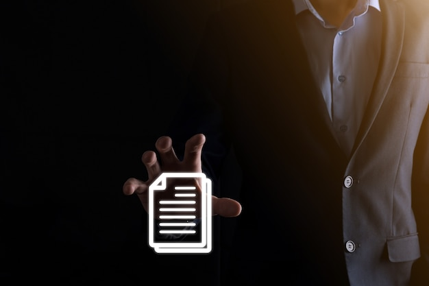 Businessman man holding a document icon in his hand document management data system business internet technology concept. corporate data management system dms