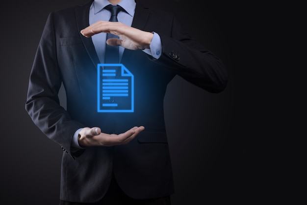 Businessman man holding a document icon in his hand document management data system