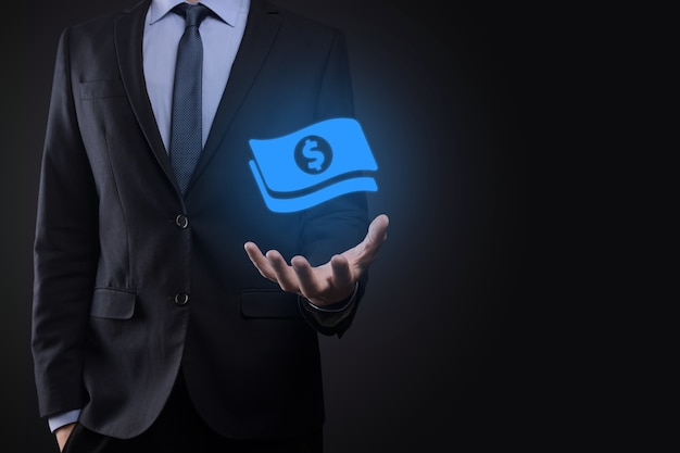 Businessman man holding money coin icon in his hands