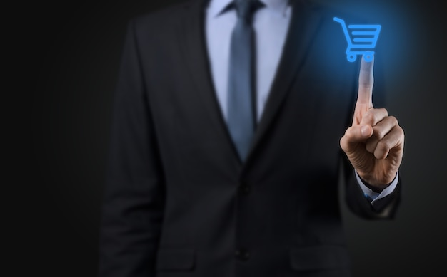Businessman man holding shopping cart trolley mini cart in business digital payment interface.business, commerce and shopping concept.
