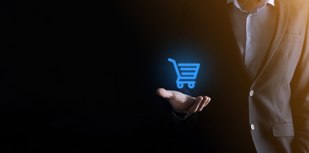 Businessman man holding shopping cart trolley mini cart in business digital payment interface