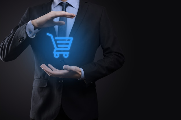 Businessman man holding shopping cart trolley mini cart in business digital payment