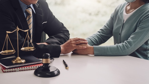 Businessman man lawyer entrusts trust work to customer shaking hands at office.