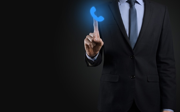 Businessman man in suit on black background hold phone icon.