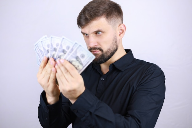 Businessman man with a fan of money in his hands
