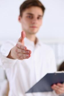 Businessman offer hand to shake as hello closeup
