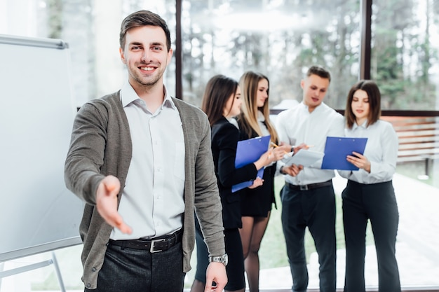Businessman offer hand to shake as hello in office. serious business, friendly support service, excellent prospect, introduction or thanks gesture, gratitude