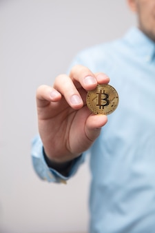 Businessman offers bitcoin in the hand