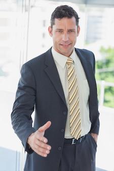 Businessman offfering hand for handshake