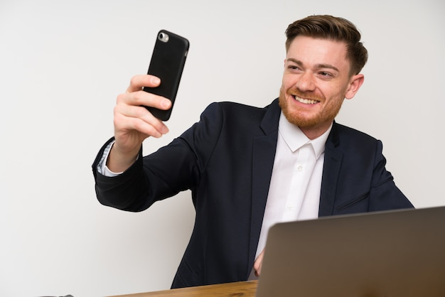 Businessman in a office with mobile