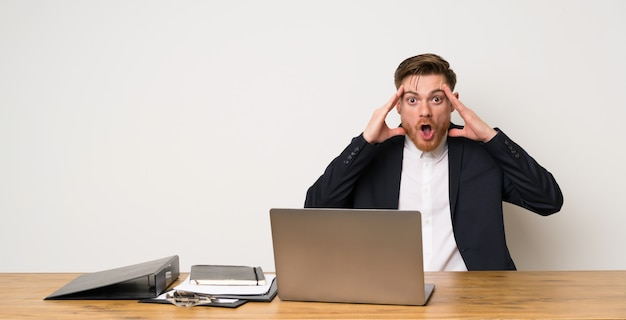 Businessman in a office with surprise expression