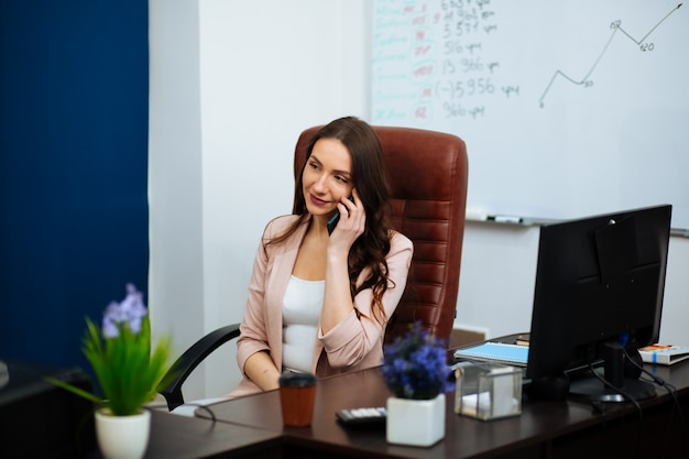 Businessman in office working with phone