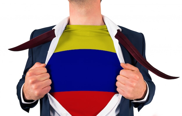 Businessman opening shirt to reveal colombia flag