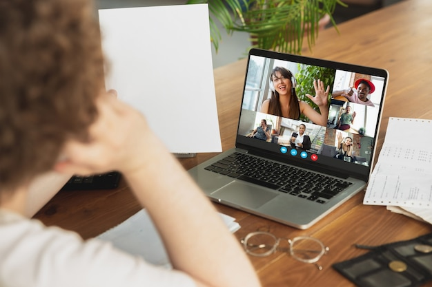 Businessman participate video conference looking at laptop screen during virtual meeting, videocall webcam app for business, close up. remote working, freelance, education, lifestyle concept.