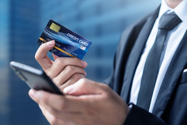 Businessman pay or shopping by credit card with smartphone