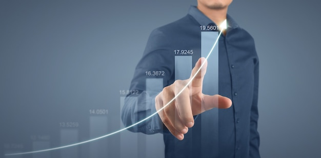 Businessman plan graph growth and increase of chart positive indicators in his business