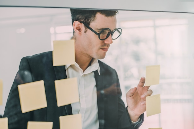 Businessman planning with sticky notes