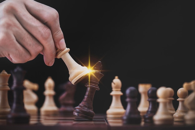 Businessman play with chess game in competition success play. concept strategy and successful management or leadership