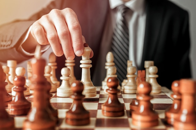 Businessman playing chess game,strategy and success concept
