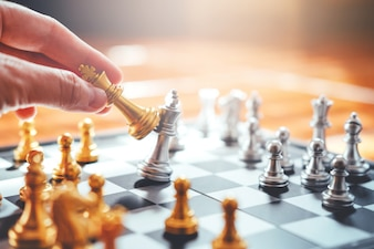 Businessman playing chess Plan of leading strategy successful business leader concept