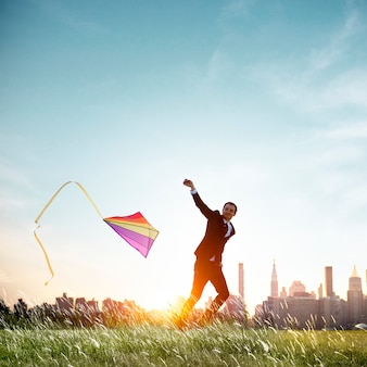 Businessman playing kite lifestyle relaxation concept