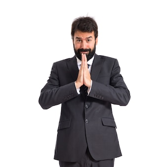 Businessman pleading over white background