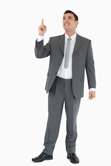 ビジネスマン、指さし、見る、上方に