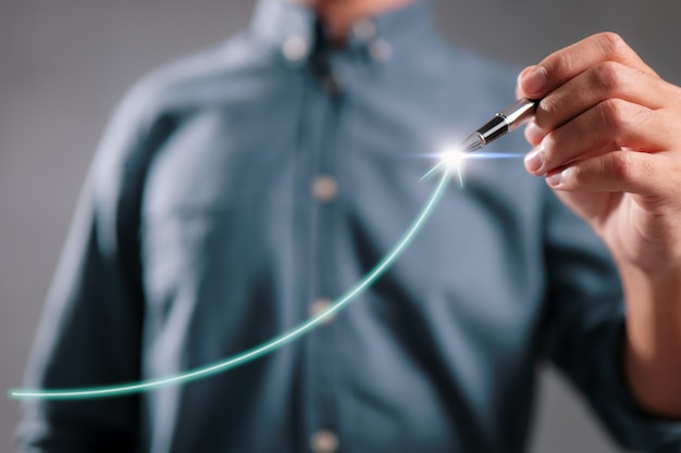 Businessman pointing arrow graph corporate future growth plan