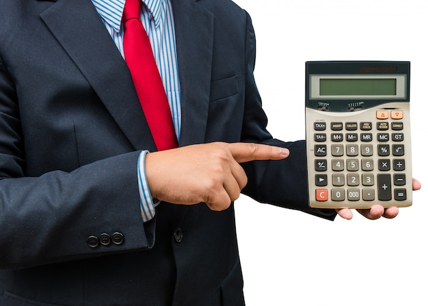 Businessman pointing to calculator on white background