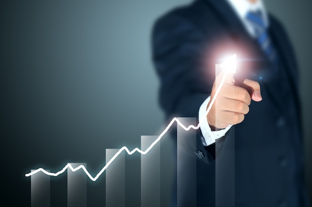 Businessman pointing graph of success