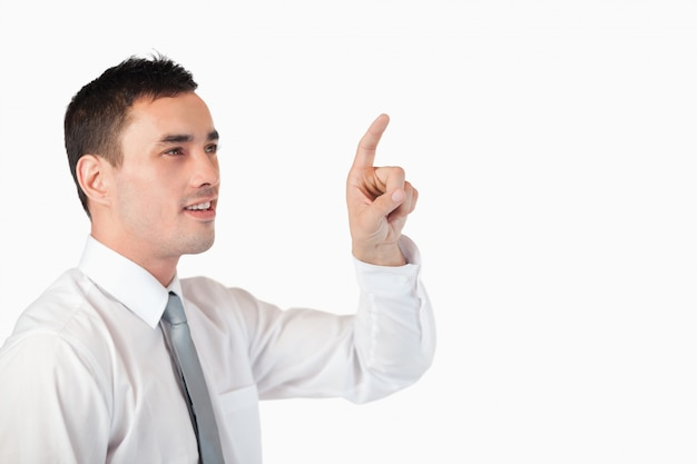 Businessman pointing at invisible screen