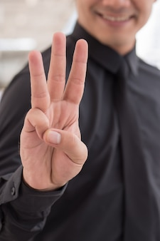 Businessman pointing up number finger hand gesture