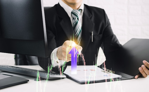 A businessman points to a rising graph.