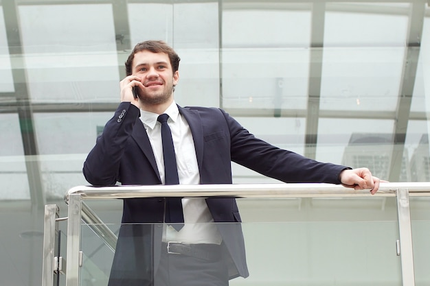 Businessman portrait. happy businessman standing, smiling, looking at camera.